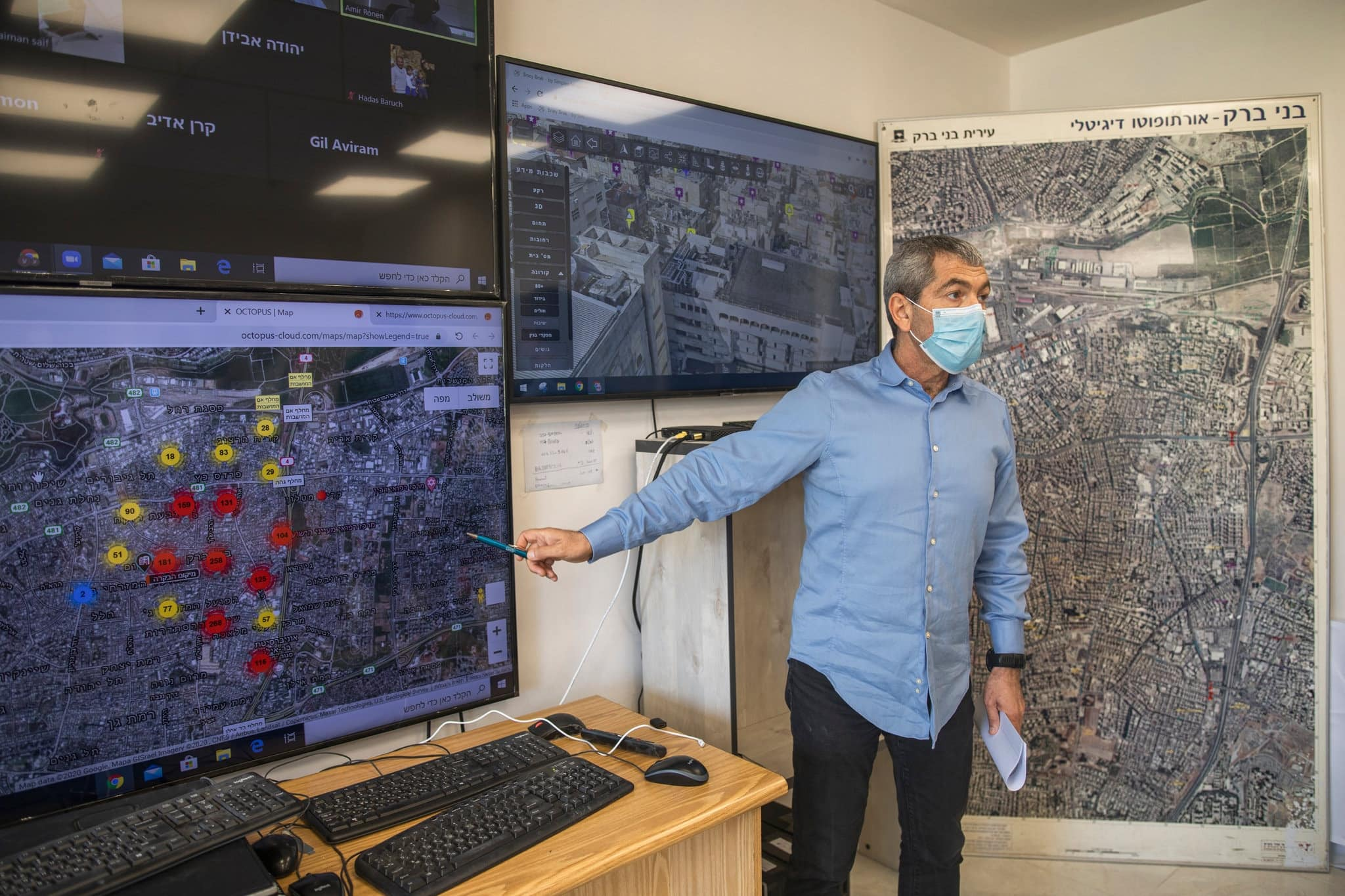 Maj. Gen. Ronny Numa at the city's virus war room, where a data-visualization system maps the sick, the elderly, yeshivas, synagogues and other information on big-screen TVs.